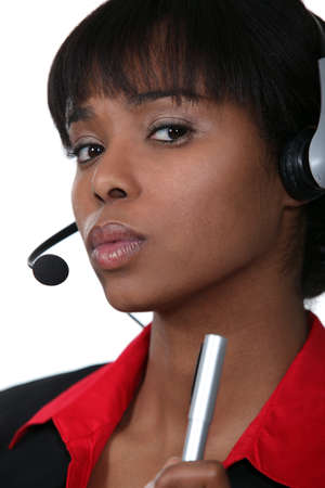 Businesswoman with a headset on Stock Photo - 15856419