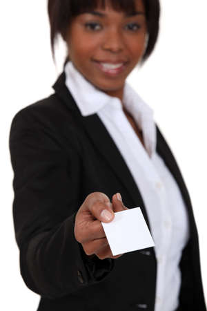 Businesswoman handing out calling card Stock Photo - 15853671