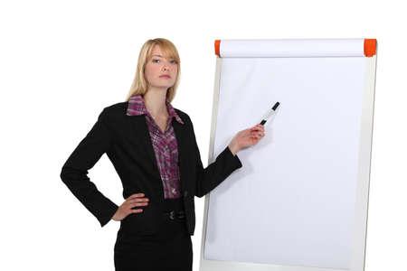 staff training: Woman giving a presentation Stock Photo