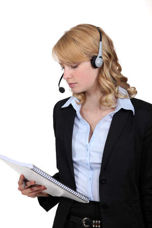 callcenter: Call-center worker with note pad Stock Photo