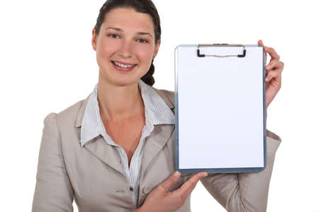 Businesswoman pointing to blank clip-board Stock Photo - 15915485