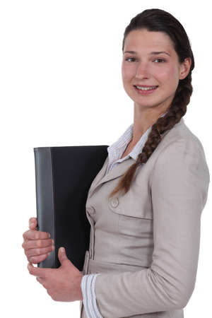 sideway: A businesswoman with a folder  Stock Photo