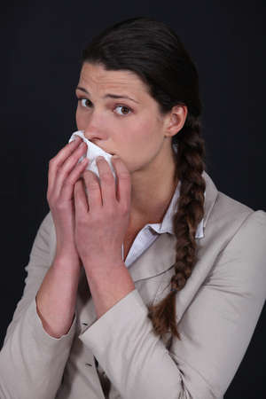 Woman wiping mouth with tissue photo