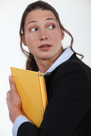 disquieted: Worried woman with a file Stock Photo