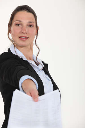 hand over: Woman handing over completed paperwork