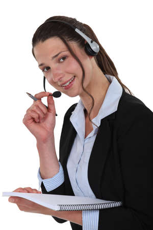 Female call-center worker with note-pad photo