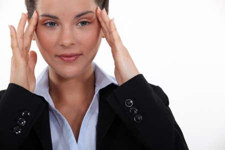 Businesswoman suffering from headache Stock Photo - 15915457