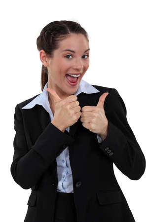 portrait of ecstatic secretary thumbs up