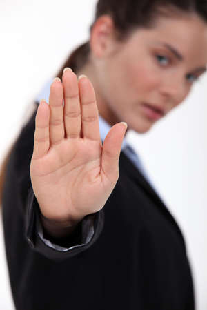 assert: woman making stop gesture with hand Stock Photo
