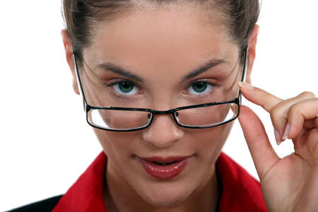 secretary with glasses lowered on her nose Stock Photo - 15915447