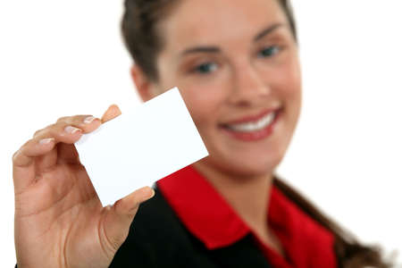A businesswoman handing her card  photo