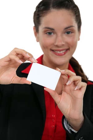 A businesswoman presenting her card Stock Photo - 15915425