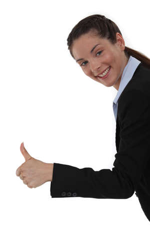 convinced: Smiling woman giving the thumb Stock Photo