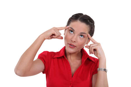 remember: Brunette trying to remember something Stock Photo