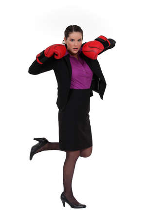 Office worker in heels and boxing gloves Stock Photo - 15915374