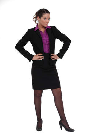 skirt suit: Businesswoman standing with her hands on her hips