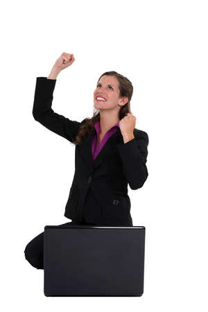 Excited businesswoman with laptop photo