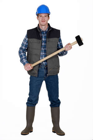 sledge hammer: Man with sledge hammer ready to work