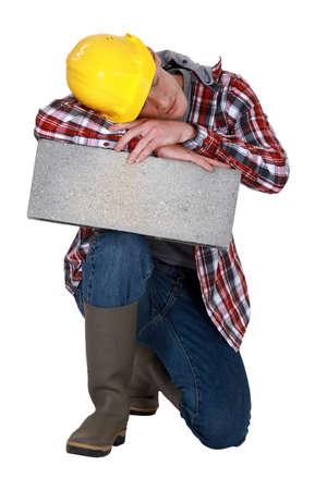 craftsman sleeping on a stone block Stock Photo - 15916091