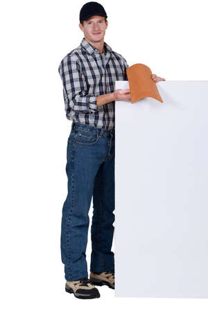trussing: Roofer stood with tile and blank poster