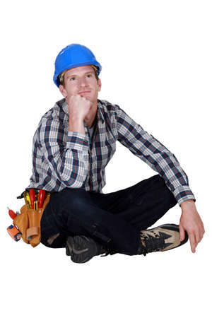 preoccupation: Daydreaming construction worker Stock Photo