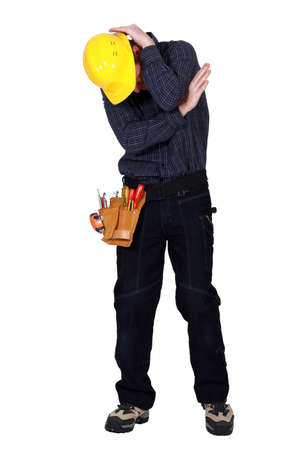 An embarrassed tradesman Stock Photo - 15915608