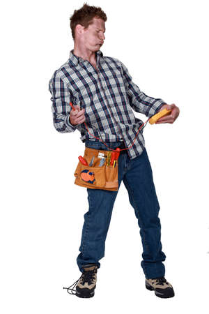 wireman: electrician holding a measurement tool Stock Photo