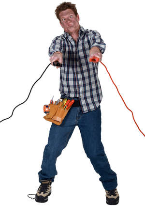 Man getting an electric shock from jump leads photo
