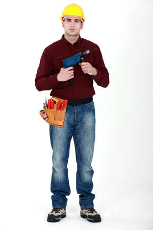 Man holding power-drill photo