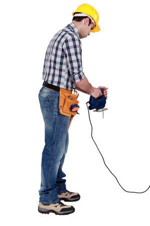 miter: Laborer with miter saw