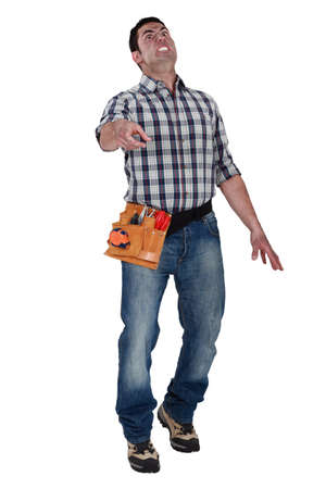 confound: Electrician doing grimace Stock Photo