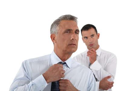 loosen up: Senior businessman adjusting tie before meeting