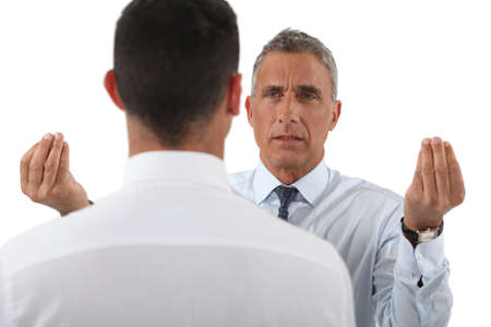 angry boss: Angry boss talking to employee Stock Photo
