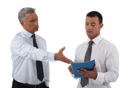 angry boss: Angry boss displaying his displeasure to his employee