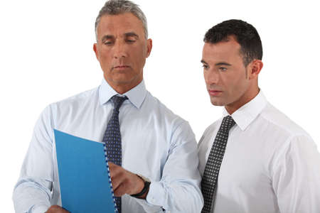 combined effort: businessman showing a report to a colleague