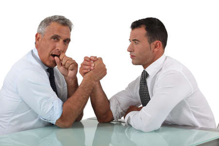 Businessmen doing arm wrestling photo