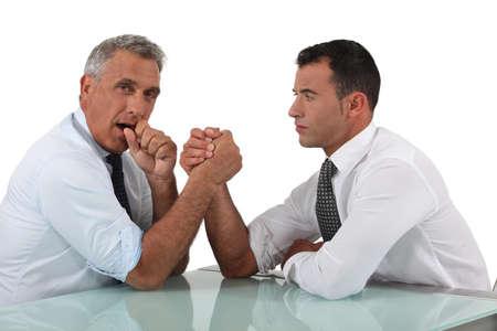 Businessmen doing arm wrestling Stock Photo - 15915920
