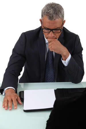 Concentrated man looking at a sheet of paper Stock Photo - 15915934