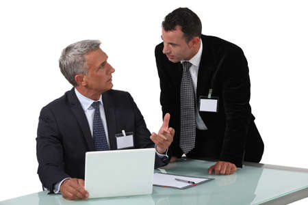to argue: Two businessmen having heated debate Stock Photo