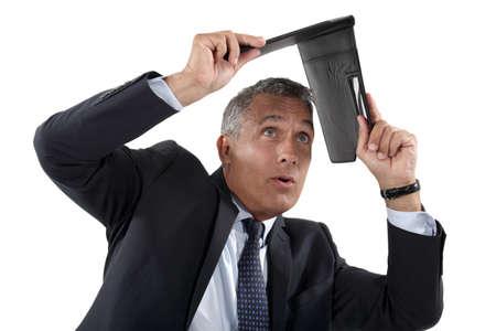 Businessman shielding himself with folder photo