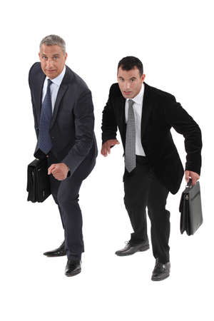succeeding: Two businessmen racing each other