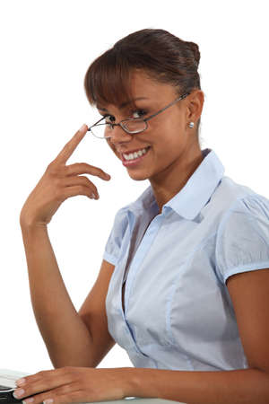 Smiling businesswoman in glasses photo