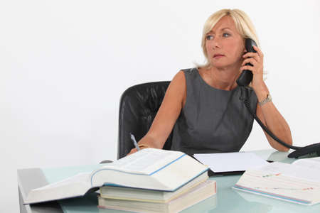 moody: A busy businesswoman  Stock Photo
