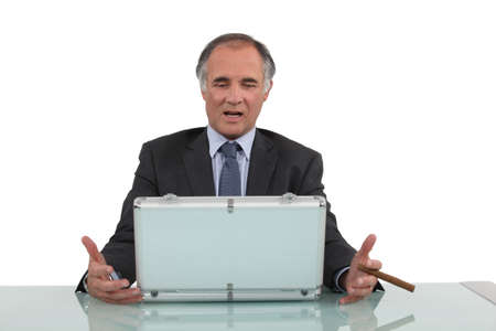 Senior businessman sat with cigar and metal briefcase Stock Photo - 15915591