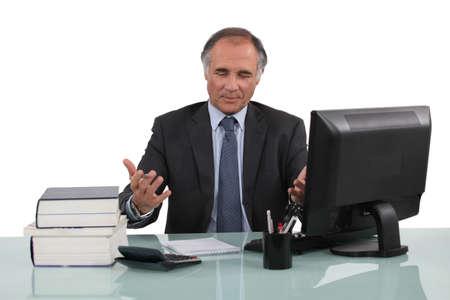 confound: businessman working at his desk