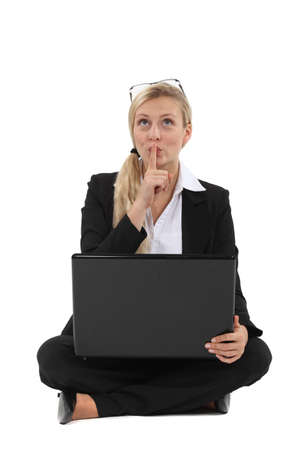 Businesswoman thinking at her laptop Stock Photo - 15915544