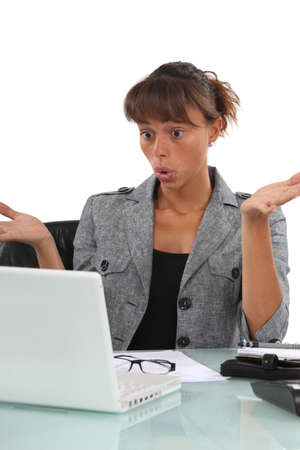 Confused businesswoman sat at desk Stock Photo - 15916191