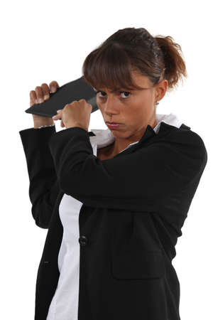 enrage: young businesswoman looking angry