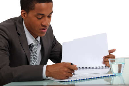spelling: Businessman reviewing a report