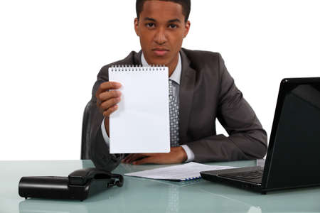 Businessman with a blank notebook photo